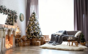 Stylish interior of living room with decorated Christmas tree