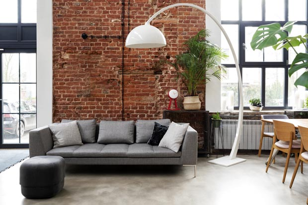 Living room interior in loft apartment in industrial style with