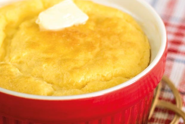 cheese souffle on a red and white cloth in a red bowl